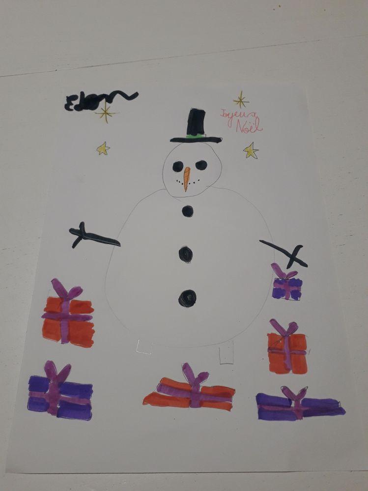 Bonhomme de neige attendant le père Noël  Eden 6ans