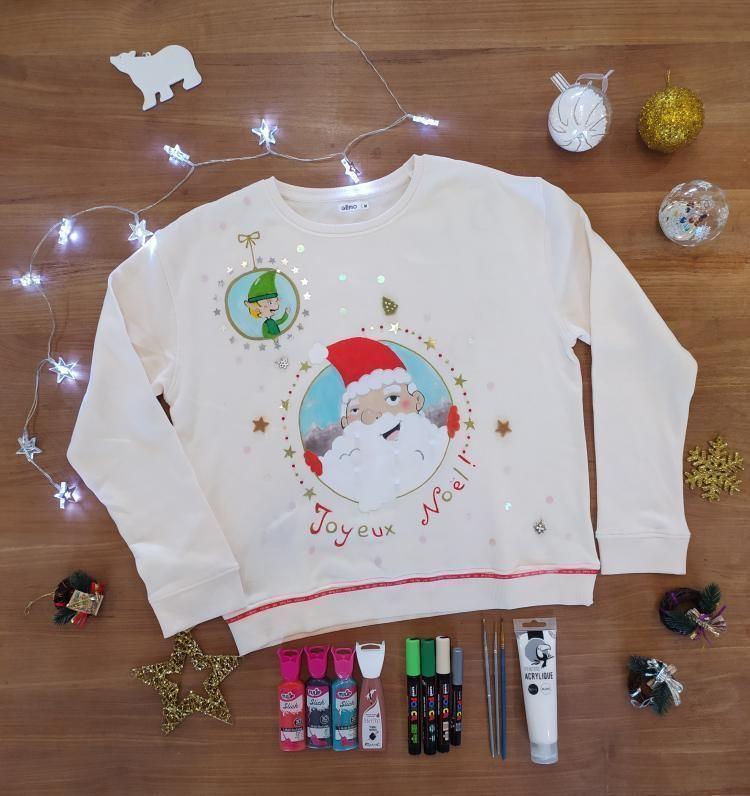 Bonjour ! Voici ma participation au concours de pull/sweat de Noël ! Pour la customisation j'ai utilisé de la peinture acrylique blanche, de la peinture textile et des poscas (sur un sweat beige). J'ai agrémenté le tout avec des petites décos. J'espère qu'il vous plaira :-)             PS: J'ai mis en commentaire d'autres photos.