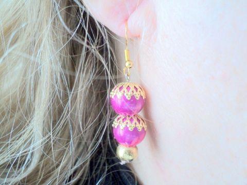 Boucles d'oreille en perles magiques