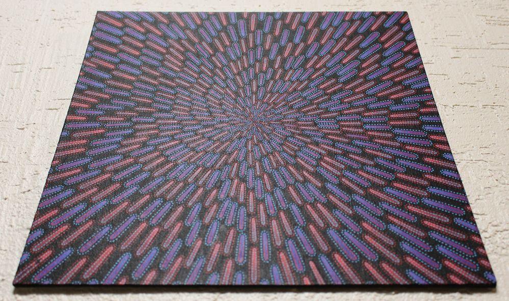Tableau moderne : Particule bleue et rouge, vue d'en dessous.