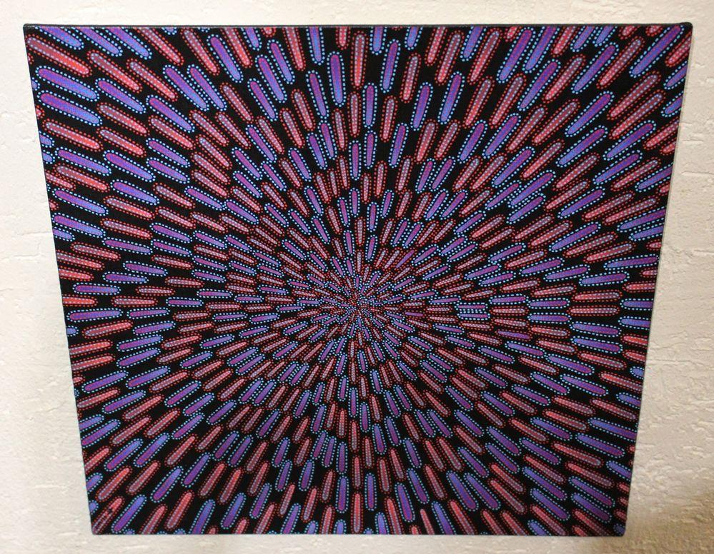 Tableau moderne : Particule bleue et rouge, vue d'au dessus.