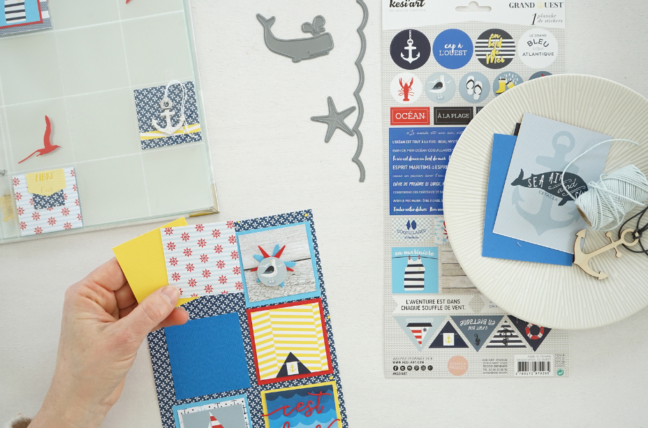3. Jouer avec les formes graphiques pour varier les mises en page en utilisant directement des pochettes cloisonnées. Idée + : Laisser des cases vides pour amener de la légèreté à l'album et y glisser une forme découpée dans un papier uni. Il est également possible de faire une mise en page très graphique : découper des carrés de 6,5 cm dans les différents papiers unis. Découper des carrés de 5,5 cm dans les papiers imprimés et les placer au centre des carrés unis. Les coller sur le fond de page Batz les en les alignant harmonieusement. Décorer ensuite chaque carré en laissant des espaces vides pour que la maman puisse coller les photos de son enfant.