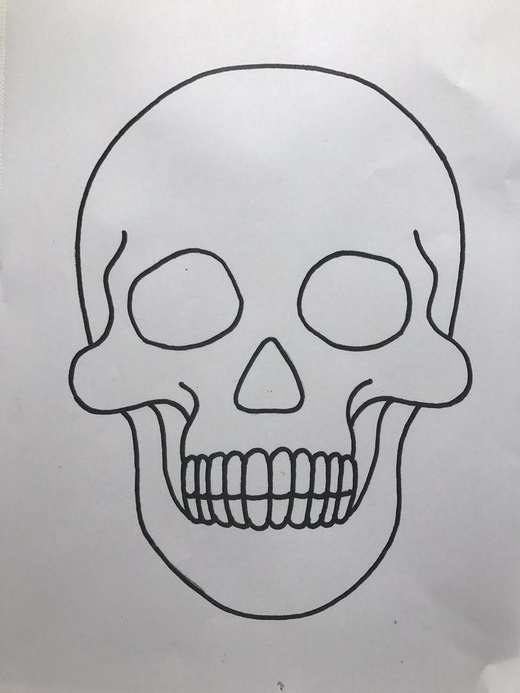 Utiliser le gabarit tête de mort ci-dessus et dessiner des motifs décoratifs.