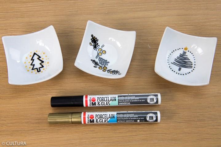 5. Pour créer des coupelles décoratives assorties, reproduire les motifs du gabarit à l'aide des porcelaine & glas paint marker noir et doré. Important : Eviter tout contact alimentaire avec les motifs dessinés.