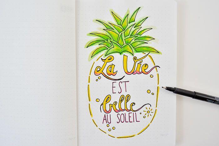 6. Marquer les contours du lettering et de l'ananas avec un feutre fin noir.