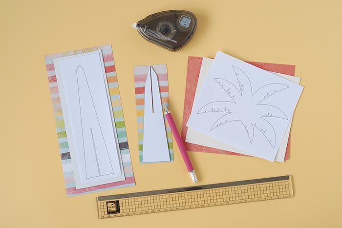 2. A l'aide du gabarit et d'un crayon, reproduire le palmier sur les papiers de la collection.