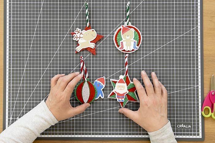 ETAPE 8/8 Idée + : Varier les formes des suspensions en répétant les actions précédentes avec les gabarits « étoile 10 cm », « étoile à facettes » et « boule 7 cm ».