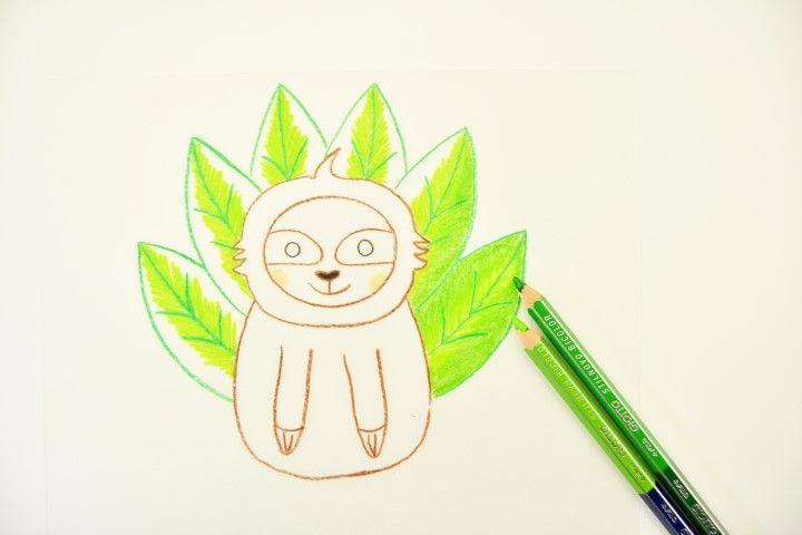 2. Créer un dégradé de verts sur les feuillages : commencer par le centre des feuillages avec un crayon vert clair puis l'extérieur avec un vert plus foncé.