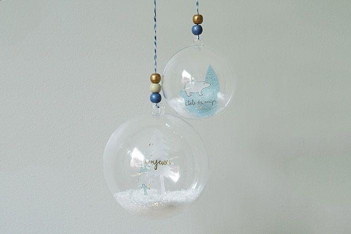 5. Créer plusieurs boules en variant les papiers calques imprimés et les découpes de scénettes.