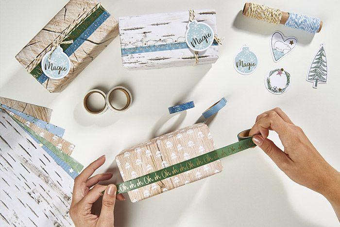 Idée n°3 : Emballer les cadeaux avec les papiers et les masking tapes de la collection. Utiliser le set d'emballage créatif avec les ficelles bicolores et les étiquettes décoratives pour finaliser les paquets cadeaux.